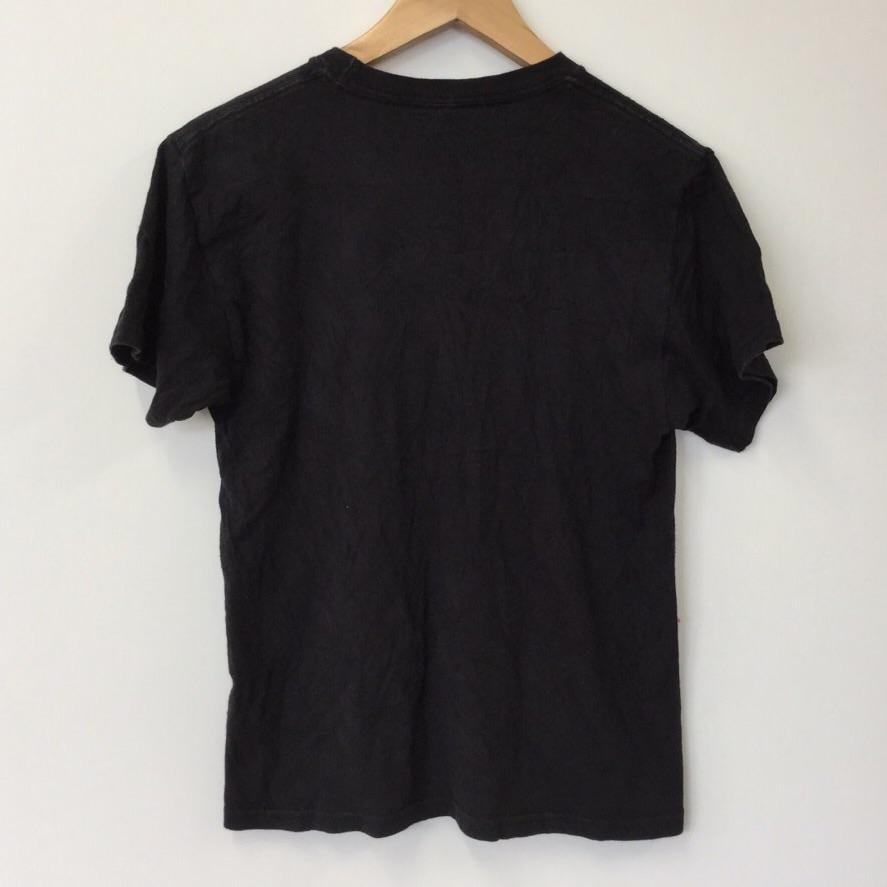 PEANUTS SNOOPY スヌーピー 半袖Tシャツ サイズM レディース ピーナッツ 黒色 古着卸 US古着 アメリカ輸入 送料無料