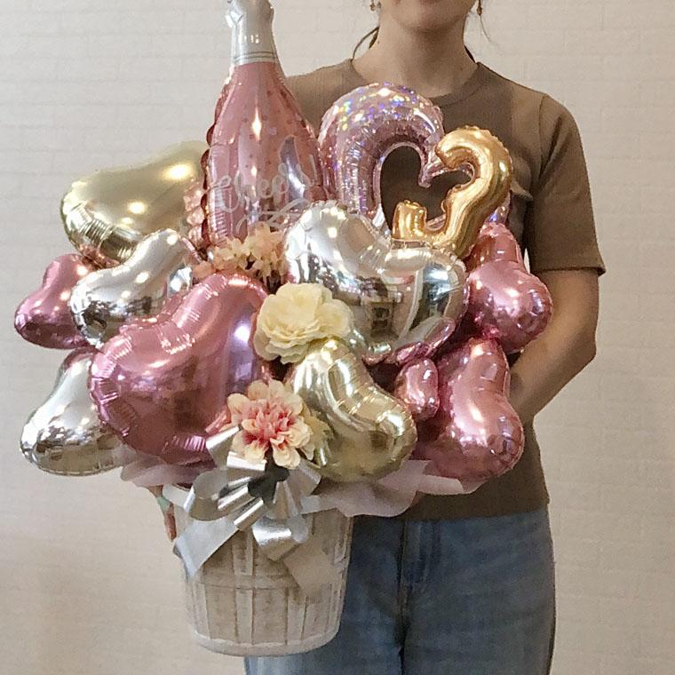 周年のお祝いやお誕生日にピッタリ☆ ピンクのシャンパンバルーンとお好きな数字のバルーンが入れられる置き型バルーンギフト