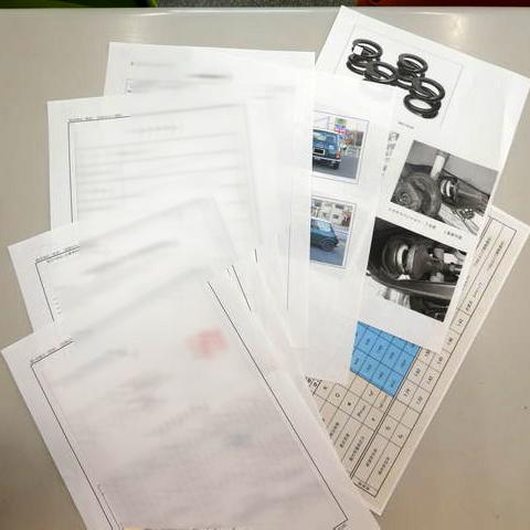 ローバーミニの「コイルサスへの変更の公認書類申請代行」