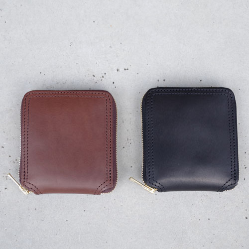 LEATHER VOYAGE ROUND ZIP SHORT WALLET