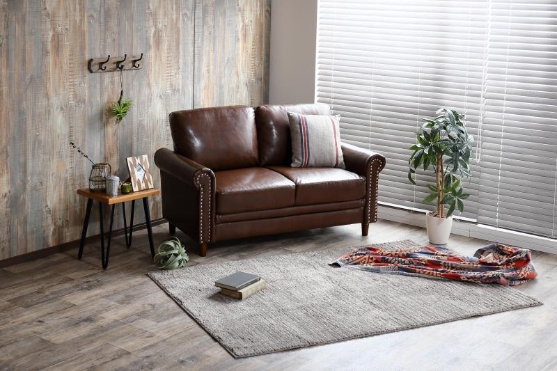 【サブスク専用】高級感のある上質な空間を生み出す鋲付きレザーソファー 2人掛け