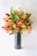 ★ 紅緋 benihi ~ グロリオサ・オンシジュームなどの華やかで花持ちの良い花々を、黒花器にアレンジしました。 ~ [ アレンジメント  Special ]  都心エリア限定配送