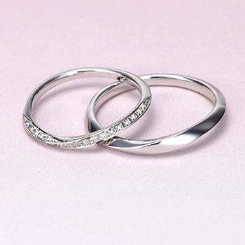 結婚指輪ペア ハードプラチナ製  緩やかなカーブデザイン  女性用はダイアを多数使った細くてエレガントな高級ハーフエタニティリング