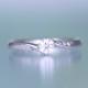 婚約指輪  メレーダイヤが斜めに入ったおしゃれなリング、クールなアイスブルーダイヤがポイント ESS192b-20H6