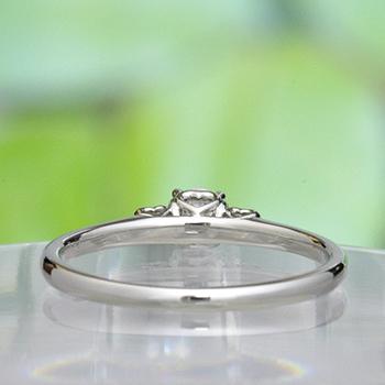 婚約指輪 両脇にピンクサファイア、ハートの透かし模様がかわいいダイヤリング EKK501ps-20FF1-Pt