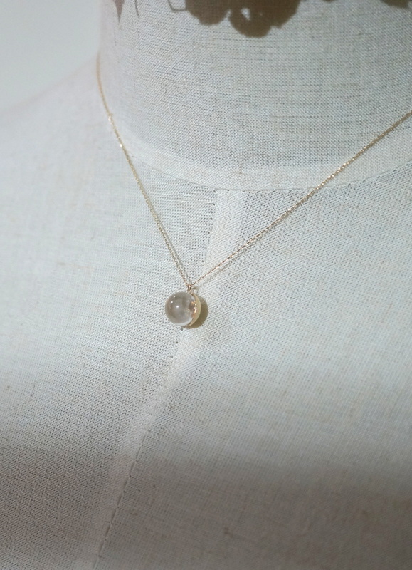in her  K10 gold drops necklace
