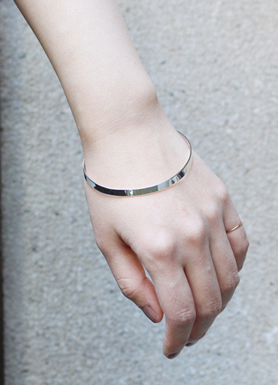 in her Light line bangle