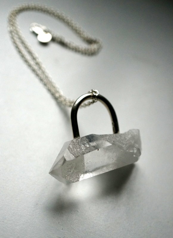 in her  Crystal point ring / necklace