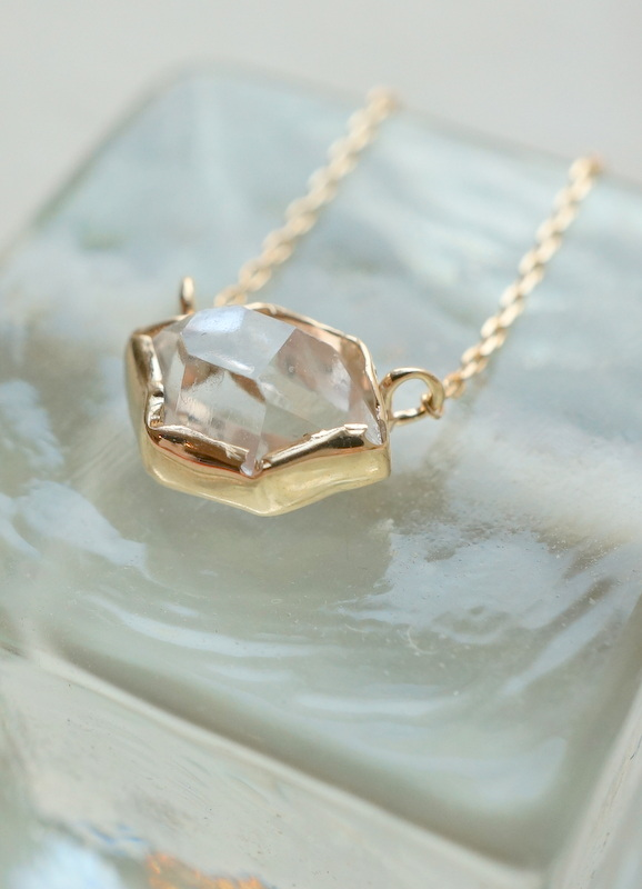 in her  K10 Wrapping Herkimer diamond  necklace