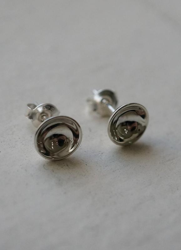 in her Input earrings