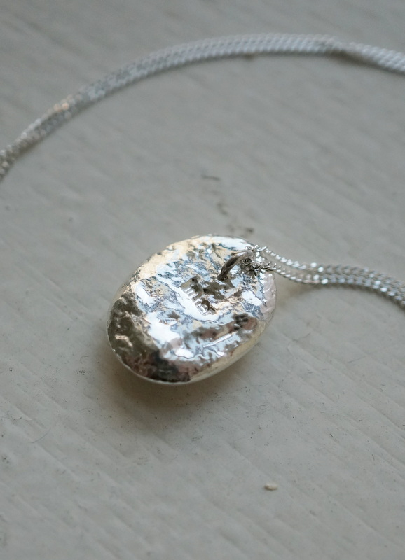 in her Silver water necklace