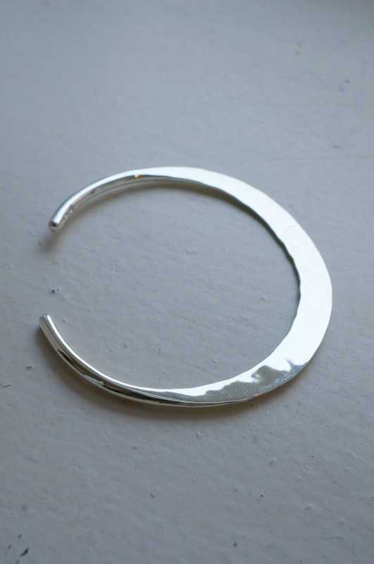 in her Moon bangle