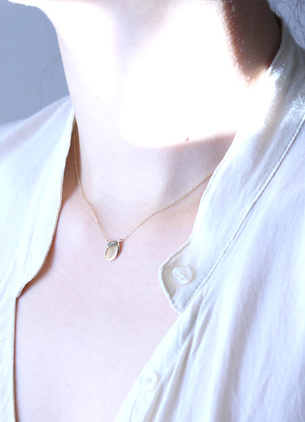 in her  K10 plate necklace