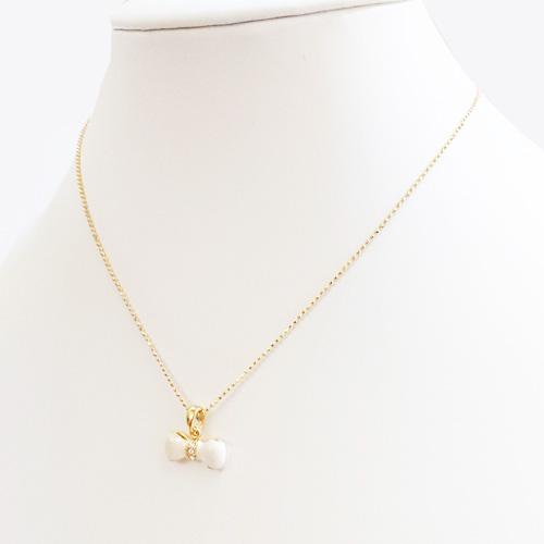 【送料無料】丸みのある白いリボンとラインストーンのネックレス/色:ゴールド系 【ネコポス送料無料/後払い・クレジット手数料無料】