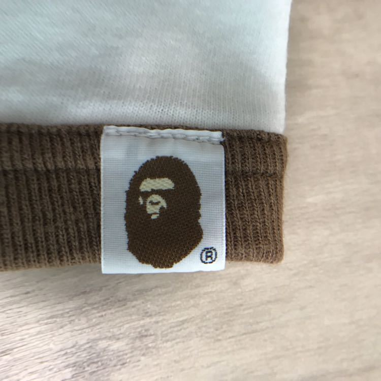 kaws ニューヨーク カレッジロゴ ロンT Lサイズ a bathing ape bape カウズ エイプ ベイプ original fake newyork NY 1st camo NIGO 長袖