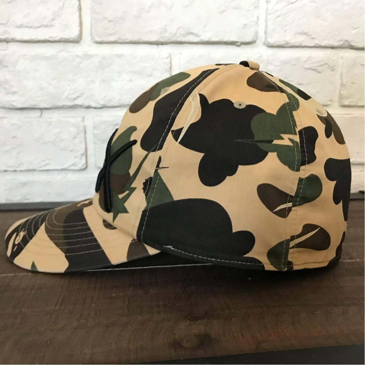 ★激レア★ kaws 1st camo yellow キャップ Mサイズ a bathing ape bape エイプ ベイプ アベイシングエイプ カウズ original fake 帽子