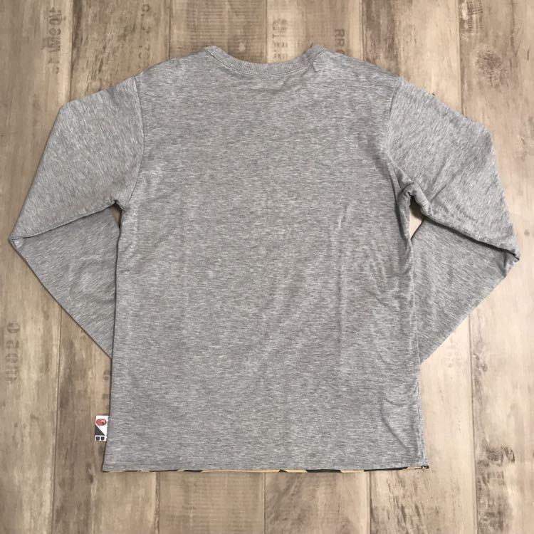 ★リバーシブル★ kaws 1st camo ロンT Sサイズ a bathing ape bape カウズ エイプ ベイプ アベイシングエイプ original fake 迷彩 Tシャツ