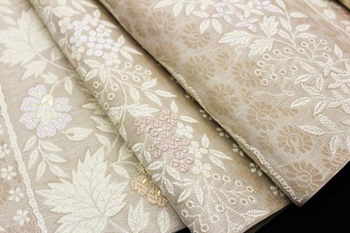 西陣織弥栄織物謹製 九寸名古屋帯「横段に唐花」