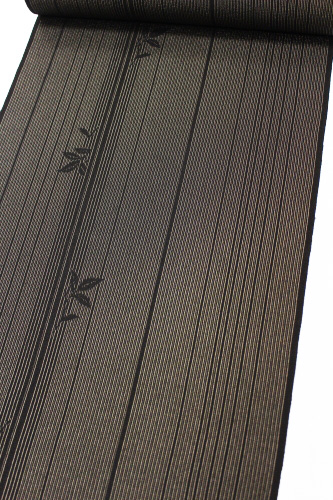 本しぼ絣十日町お召し「伝統工芸士白川貞夫謹製 柿渋染 縞に葉」