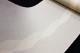 本しぼ絣十日町お召し「伝統工芸士白川貞夫謹製 柿渋染 縞に雪輪」