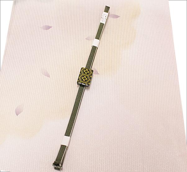 帯締め 帯留め×三分紐の2点セット 緑色×白色のリバーシブルの三分紐と亀甲に花菱柄の帯留め