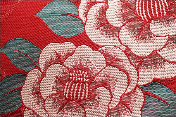 八寸名古屋帯(ポリエステル) 赤色系地に椿柄