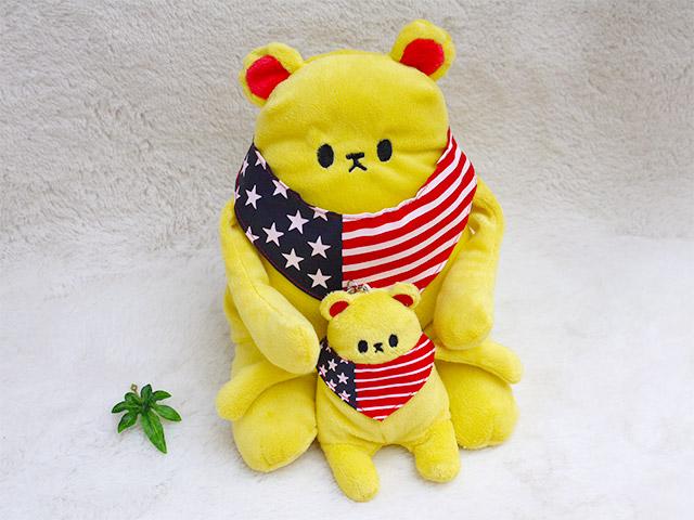 かわいいスマホスタンド クマカラ イエロー Sサイズ  国旗のバンダナがおしゃれな動物のぬいぐるみとストラップ プレゼントピッタリ、シナダの人気グッズ