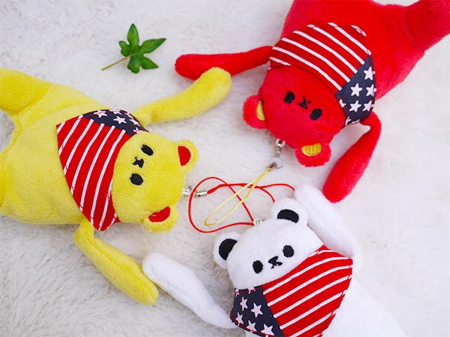 かわいいスマホスタンド クマカラ イエロー マスコットストラップ  国旗のバンダナがおしゃれな動物のぬいぐるみとストラップ プレゼントピッタリ、シナダの人気グッズ