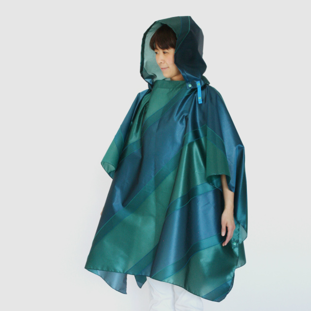 repel. Rain poncho -Green Peacock-