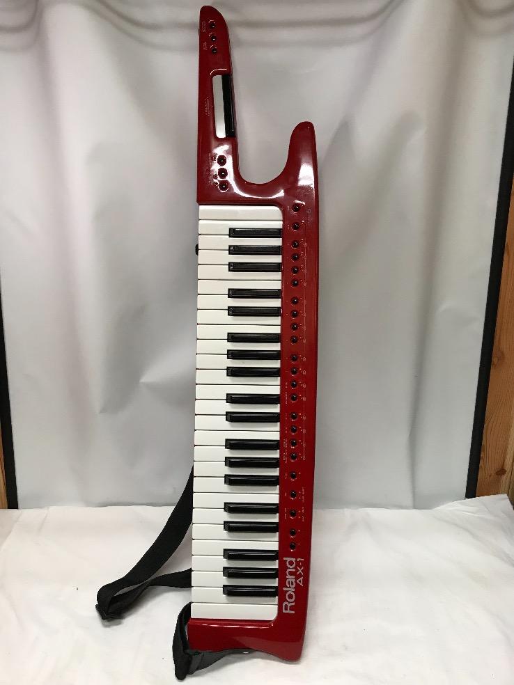 u46442 ローランド [AX-1] MIDIキーボード ショルダーキーボード 中古 通電のみ確認