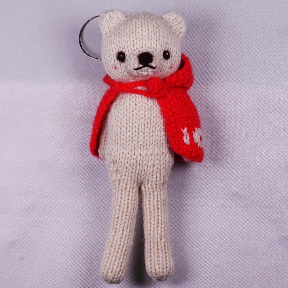 高級カシミヤの棒針の編みぐるみ。赤いマントを羽織ったブラブラ・ポーラー・ベア【16cm】