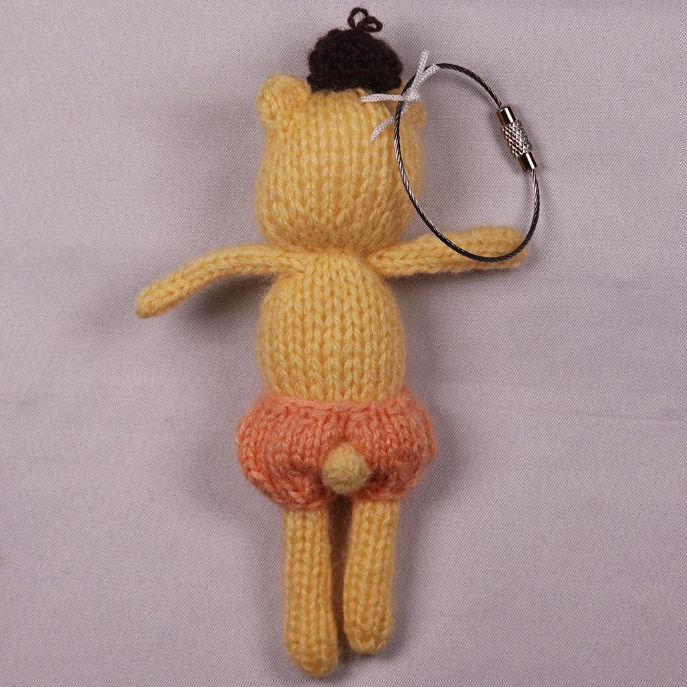 高級カシミヤの棒針の編みぐるみ。オレンジ色のパンツをはいたブラブラ・イエロベア【12cm】