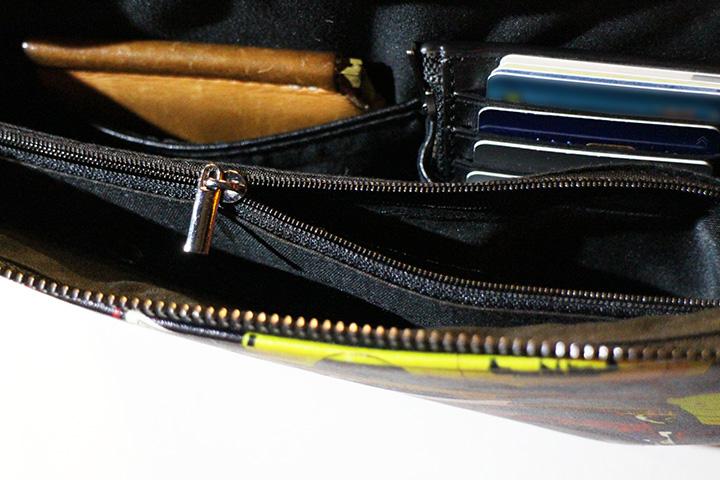 OSSANTHEHOOD clutch bag / multi