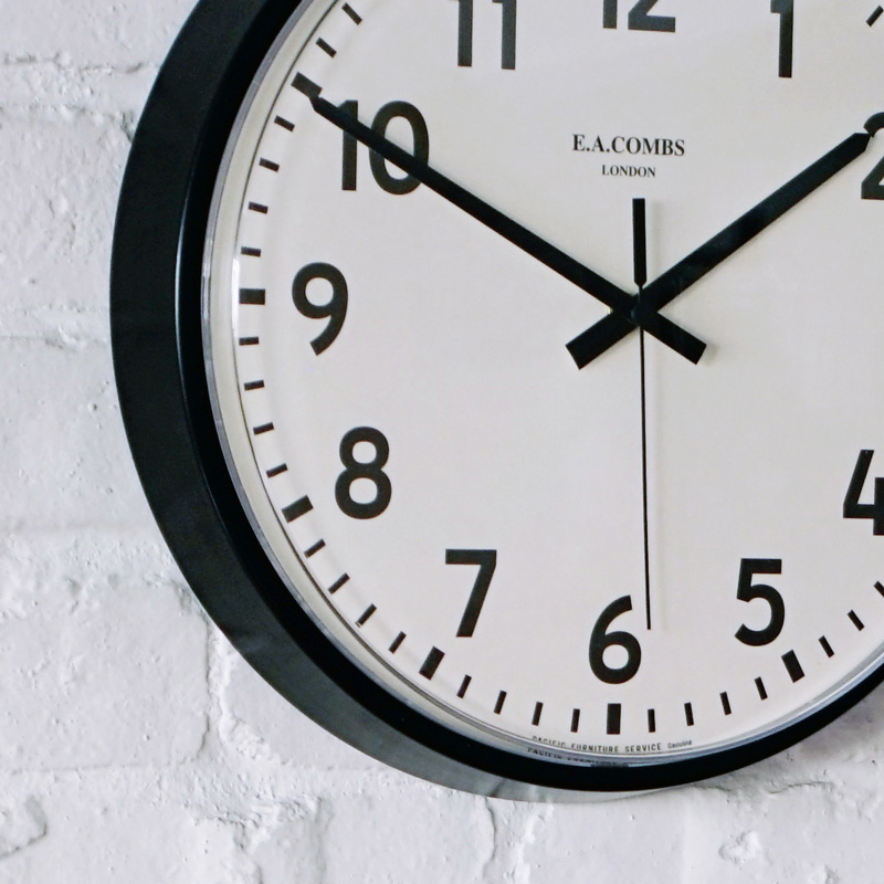 E.A. COMBS WALL CLOCK - (S) φ315