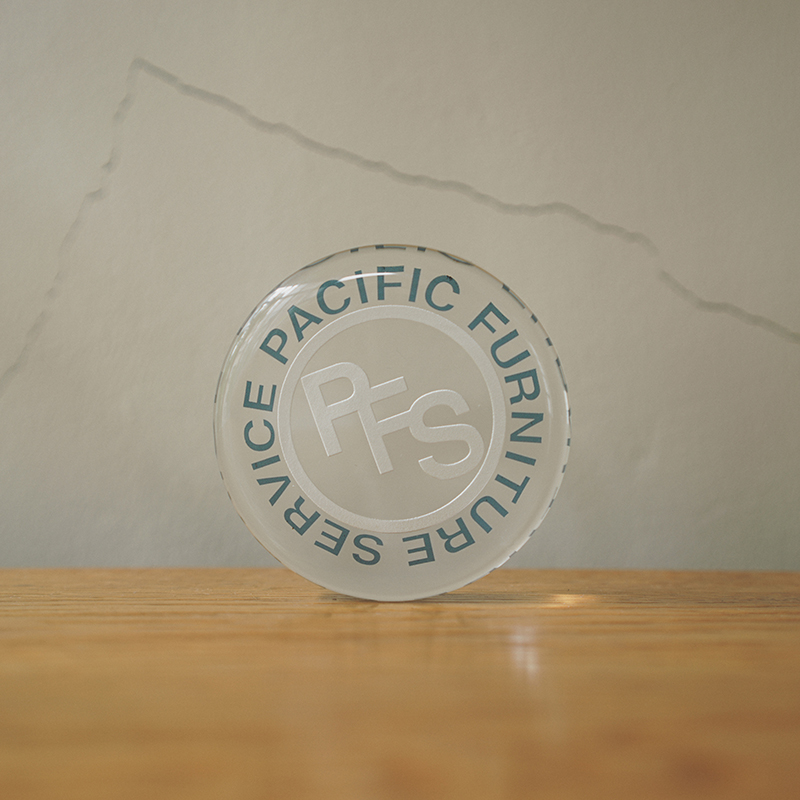 P.F.S. GLASS PAPER WEIGHT