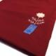 丸いお花の赤いバッグ