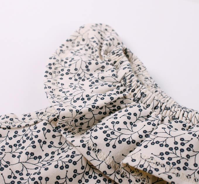 【20%OFF】グリーンコットン( Müsli by Green Cotton )プチフリルスカート付きロンパース