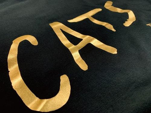 キャッツ ロゴTシャツゴールド黒 M