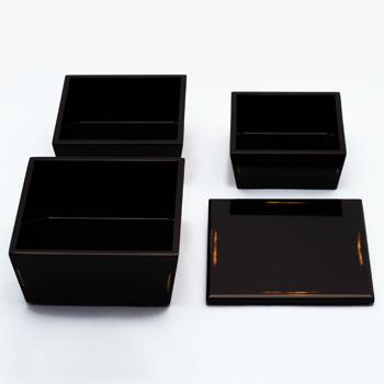 台形入子三段重箱(変根来-黒)
