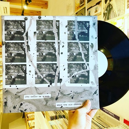 YOU COULD BE A COP / AMID THE OLD WOUNDS // Split  LP