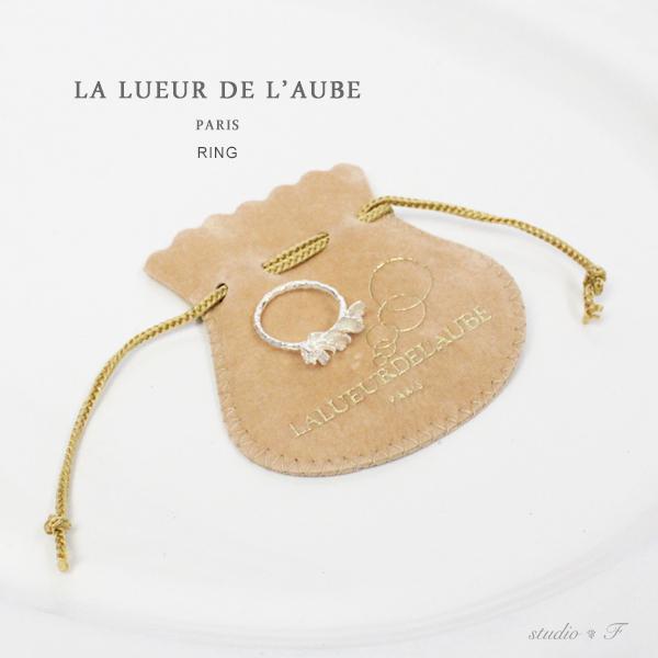 La Lueur de l'Aube<br>(ラ・ルウール・ドゥ・ロウブ)<br>花びらモチーフ+ホワイトトパーズ リング