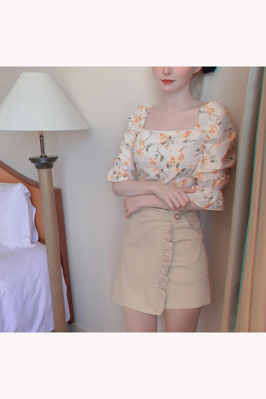 巻きスカート風ビッグボタンフリルショートパンツ