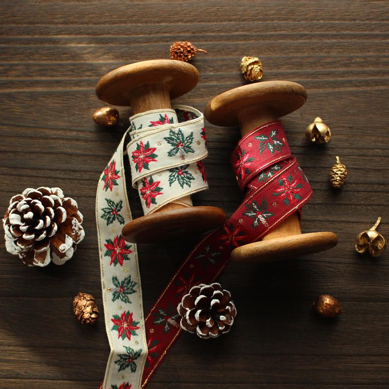 3301-25mm クリスマス柄チロリアンテープ ヒイラギとロウソク柄ジャガードリボン