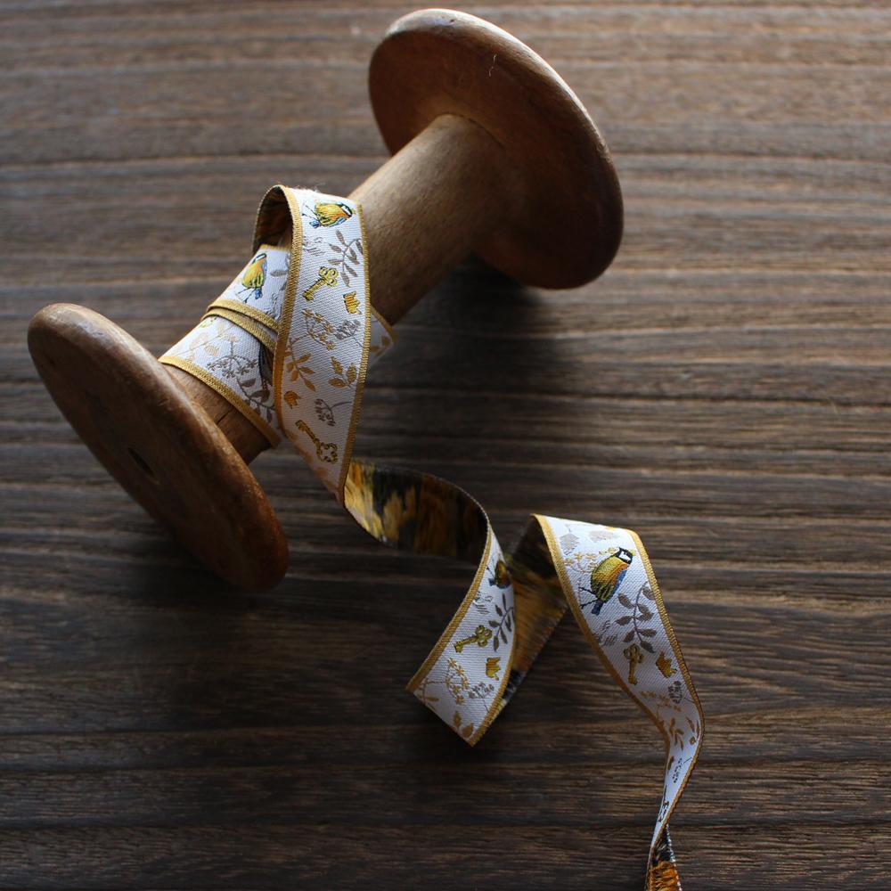 acufactumアクファクタム【50cm単位】約幅16mm/古い鍵と鳥の王子様柄ジャガードリボン チロリアンテープ