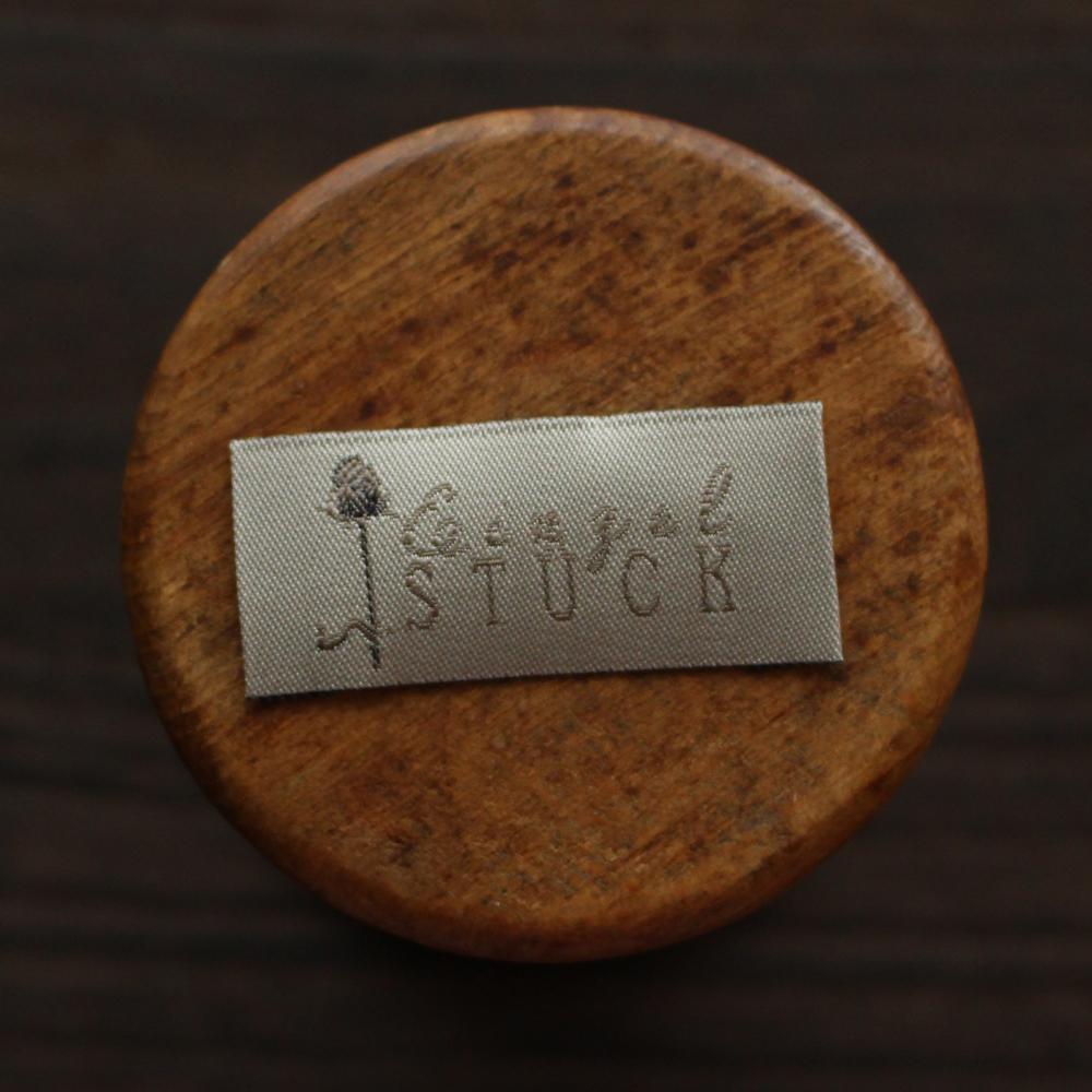 【acufactum299】 約2cm×約4.5cm-アザミのタグ ラベル 織ネーム
