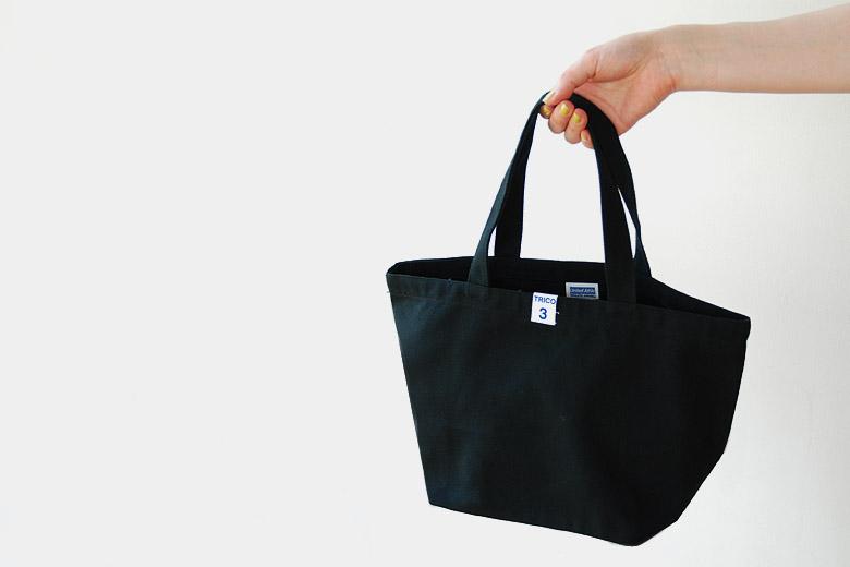 顔のランチバッグ ブラック / デザイン・アゲインスト・トレンド
