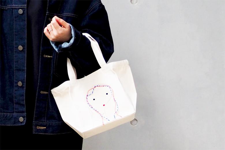 顔のランチバッグ ナチュラル / デザイン・アゲインスト・トレンド