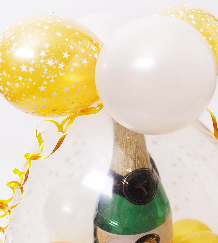 ウェディングリングときらきらゴールドスター、シャンパンのラッピングバルーン【結婚式のバルーン電報】