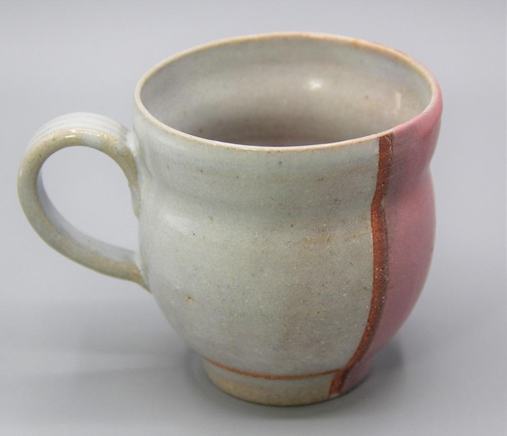 (不毅窯)桃色掛け分けマグカップ