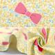 【数量5から】 生地 『オックス Tip-top collection (ティップトップコレクション) お花リボン ミルクイエロー DT10330-1B』